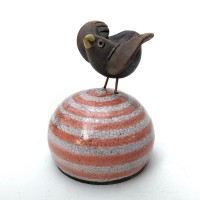 Raku Bird on orange striped buoy - wings open