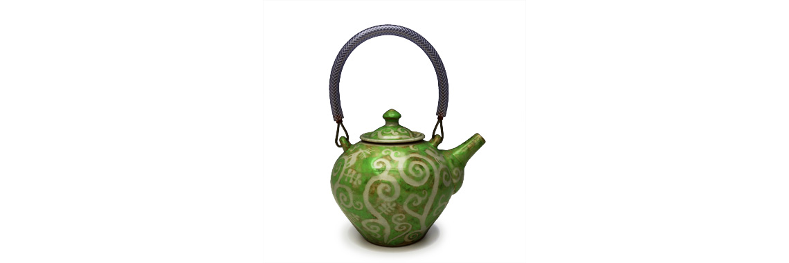 Teapot - Green glaze over resist